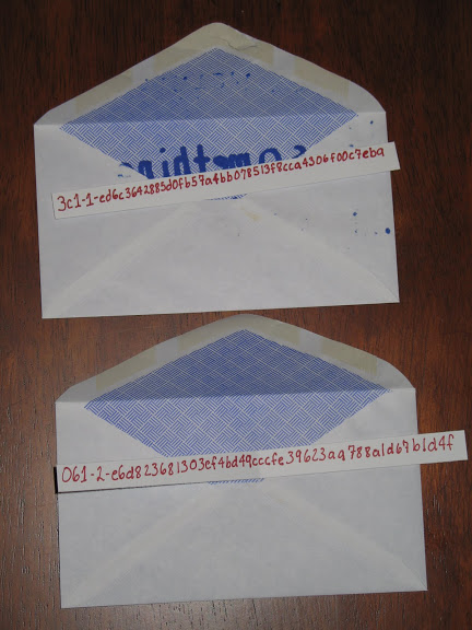 Two opened envelopes with secret shares